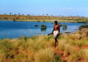 Tom's grandfather, Nyilpirr Ngalyaku 'Spider' Snell, at Kurtal -- a sacred waterhole in the Great Sandy Desert -- in 2002.
